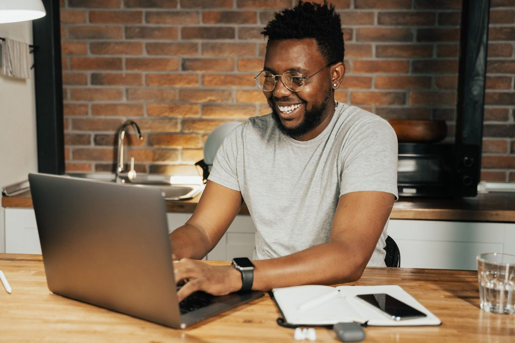 Image of a person using their laptop at a desk.